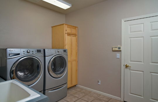 laundry-room-with-sink-and-storage