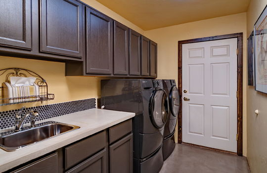 Laundry Room With Sink and Concrete Counters