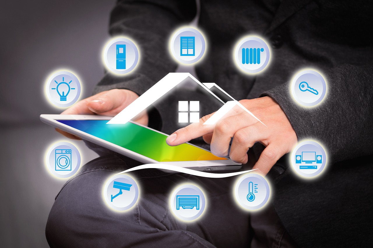 Man holding smart home tablet with technology graphics