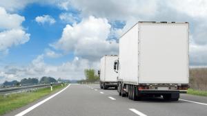 California Exodus Blog - Moving trucks going down the highway