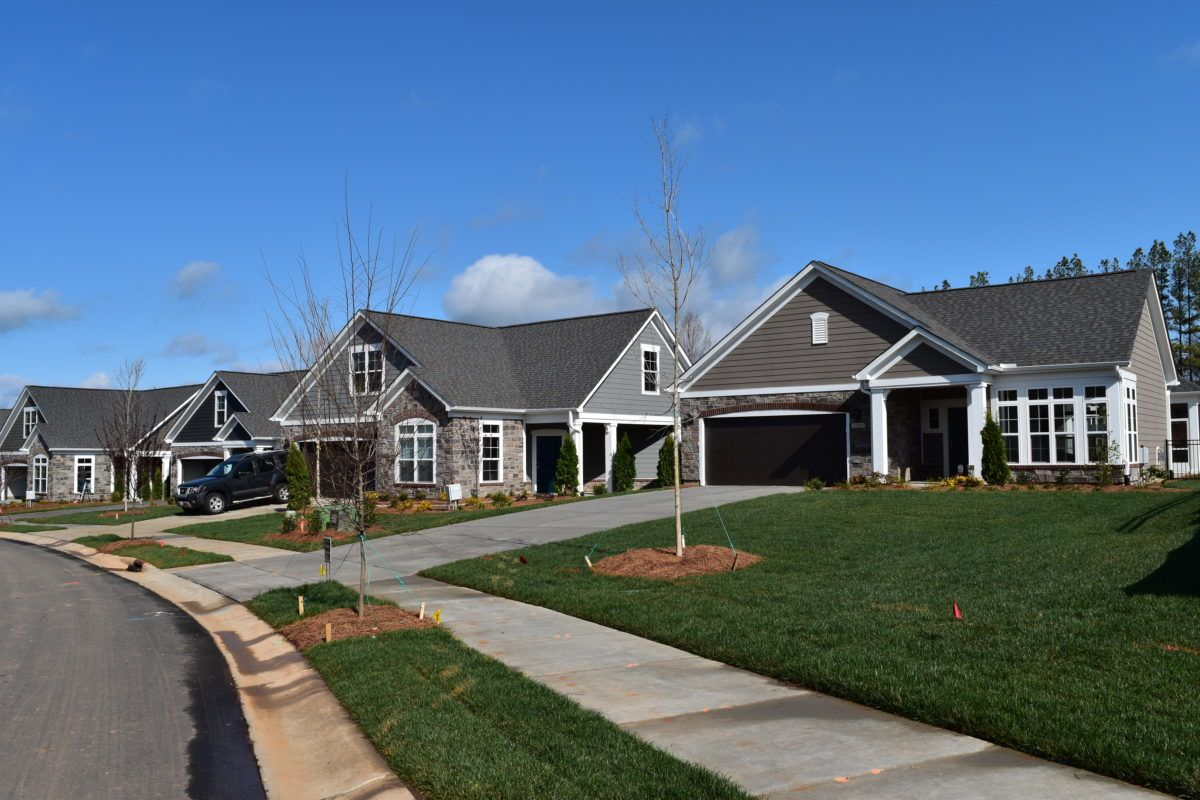 View from the street of finished homes in the Courtyards On Lake Norman