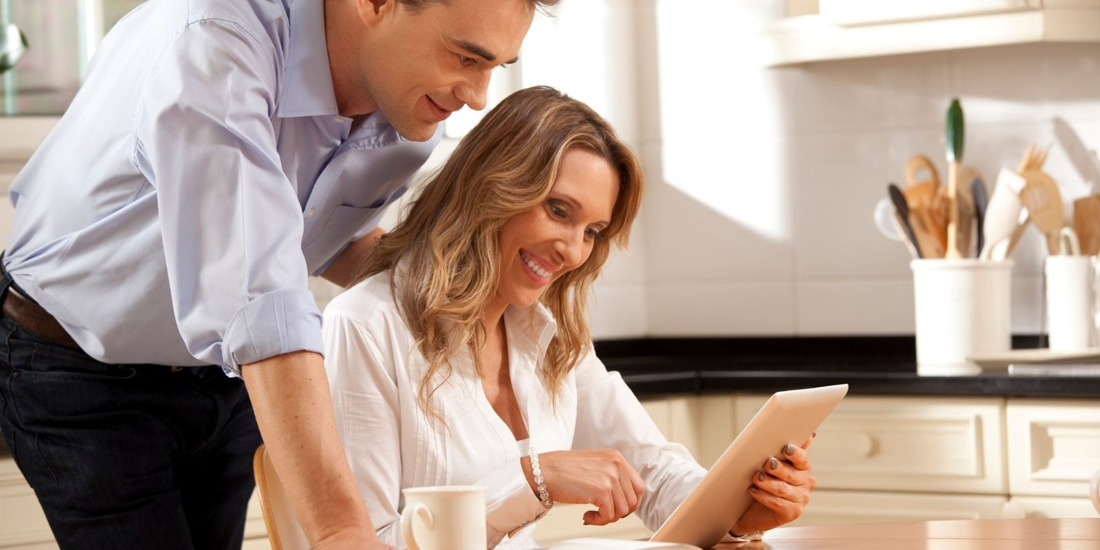 Couple Researching Ideal Homebuyer on Tablet