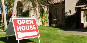 Open House Sign or Couple Touring House