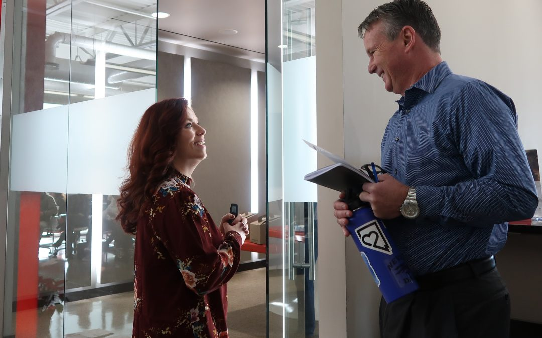 Eric Crosby and Monise McCabe cultivate a fun family vibe at Chase International's Reno office.
