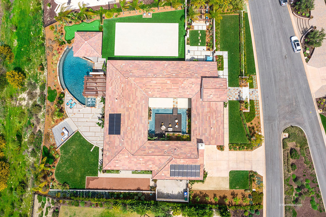 Aerial view of 16924 Crescent Creek and grounds including pool, center courtyard and private side garden