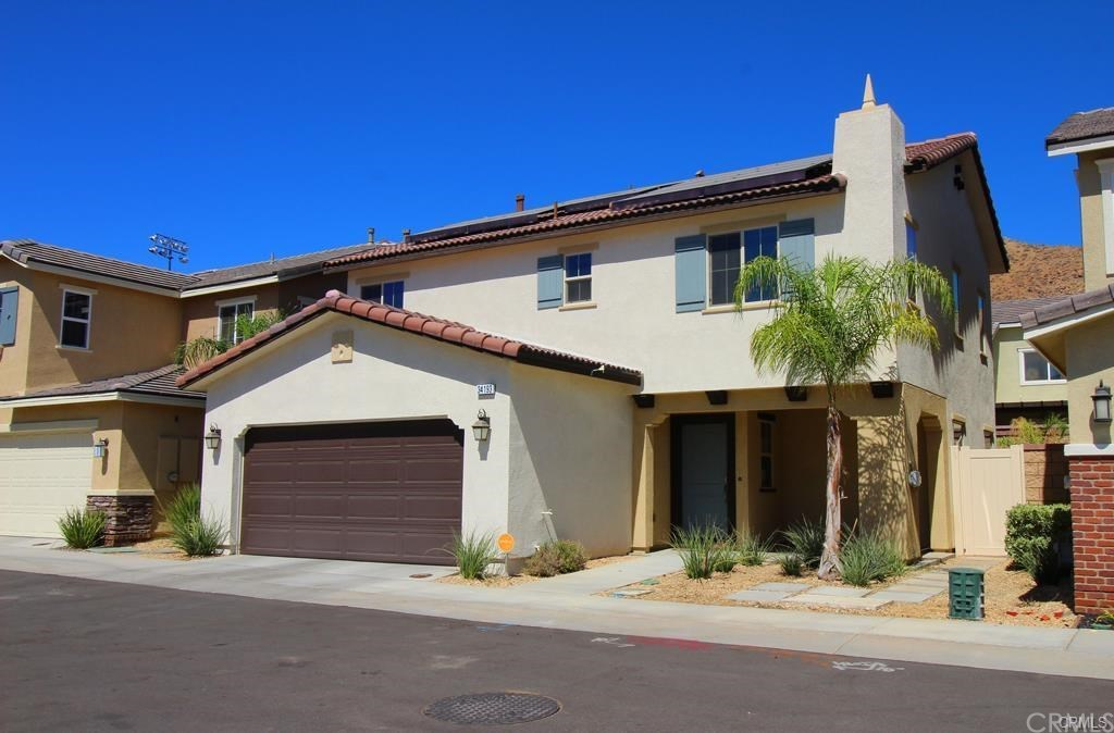 Home exterior with desert landscaping.