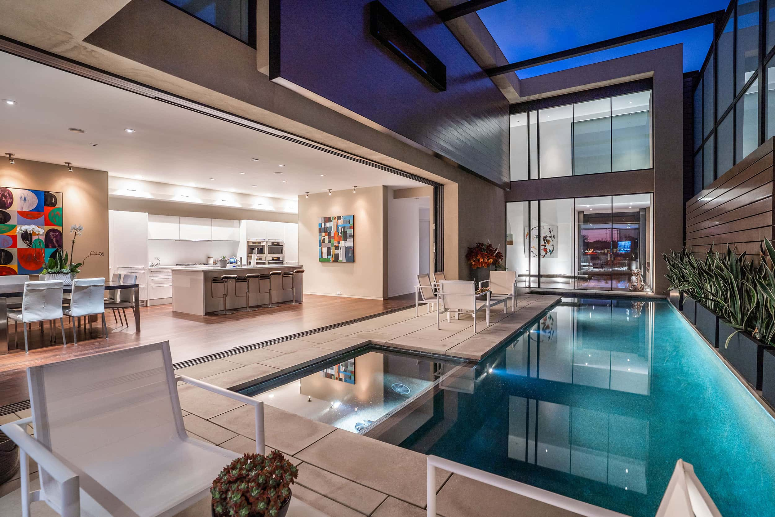 Interior courtyard with pool and open concept living space.