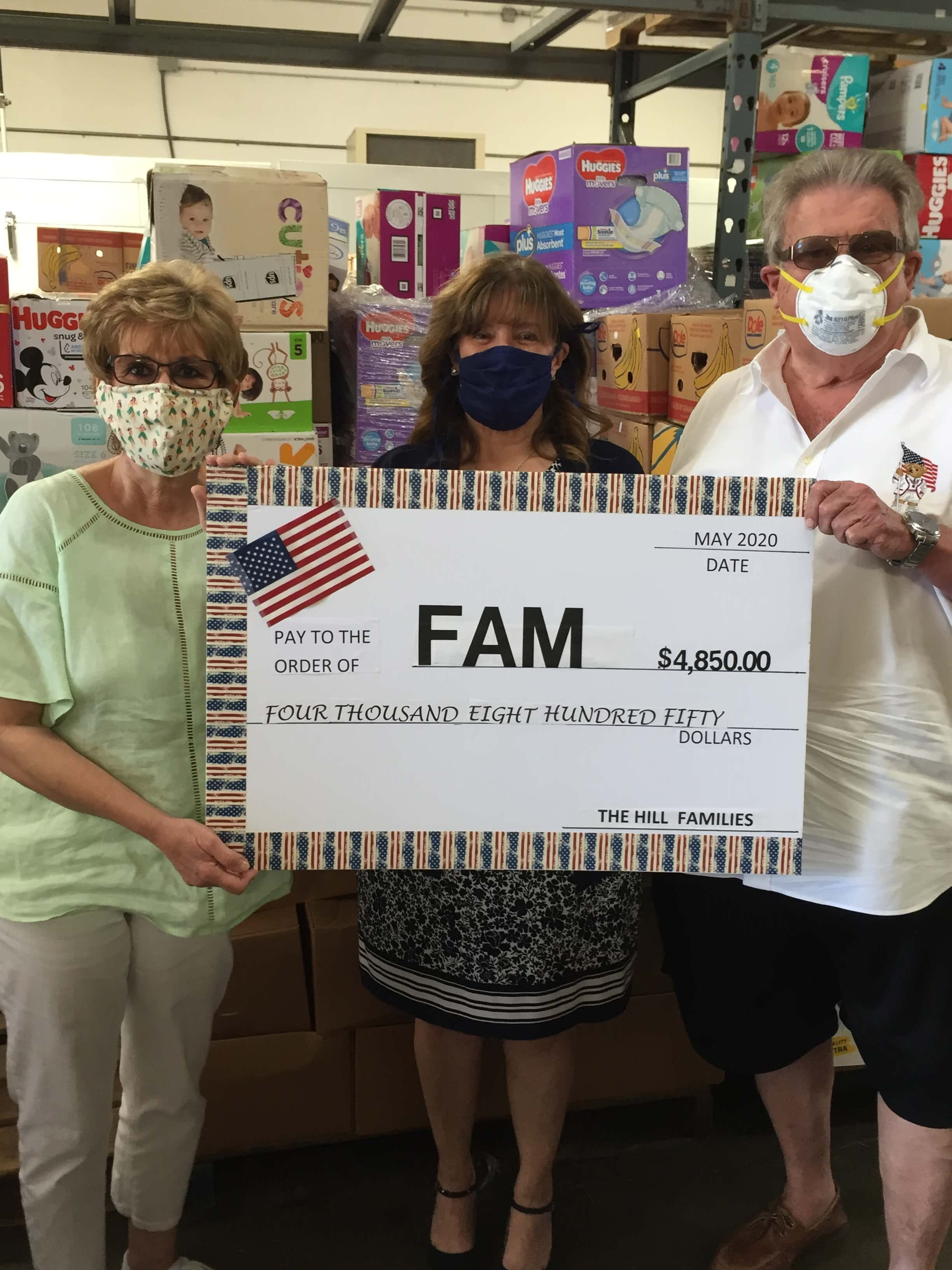 Doug and Janet Montandon present donation check to FAM organization