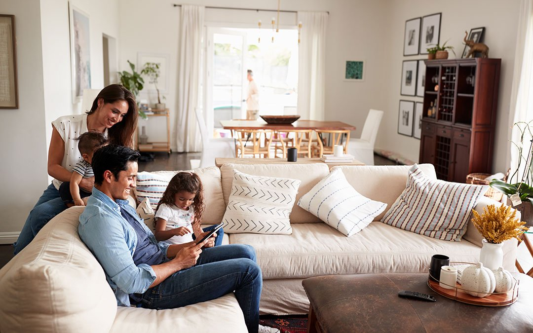 Happy family at home in a light and bright living room