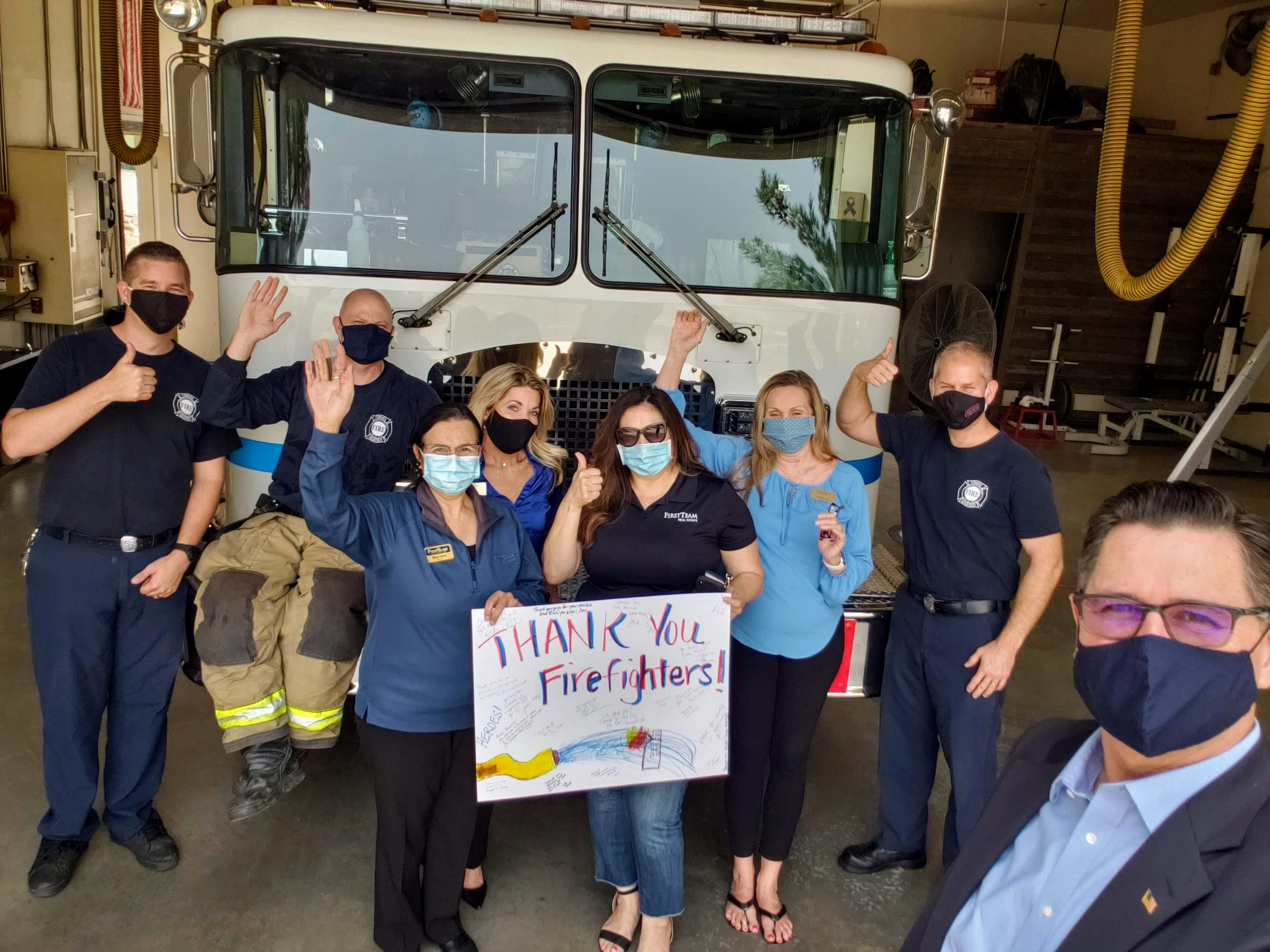 First Team Corona real estate agents wearing face masks and visiting Corona Fire Department.