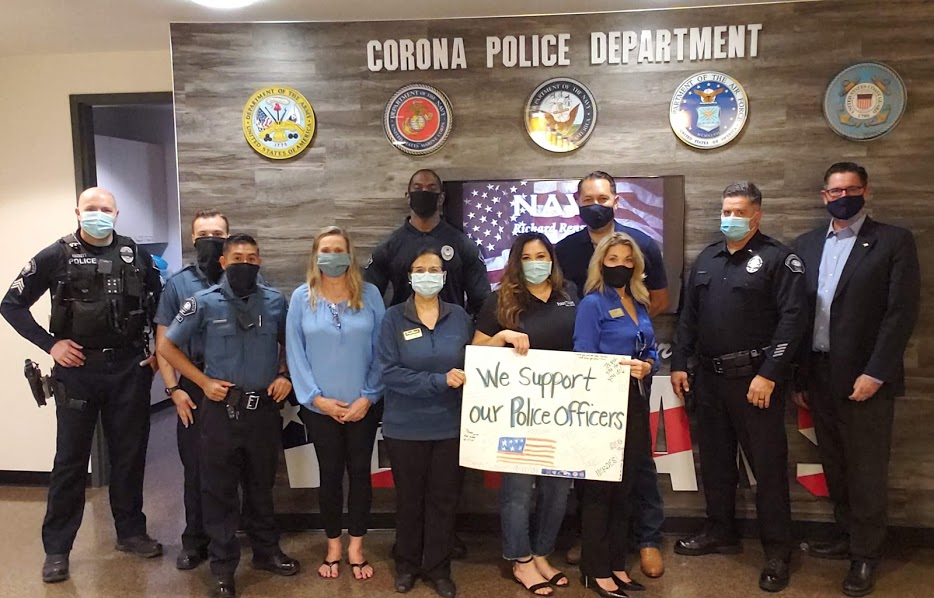 First Team Corona real estate agents wearing face masks and visiting Corona Police Department