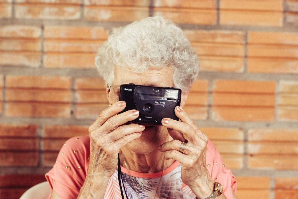 grandmother renting while taking a picture