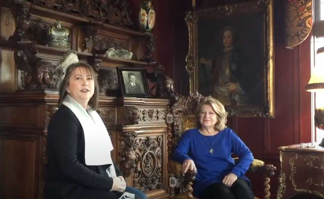 two women in a room of antique furniture