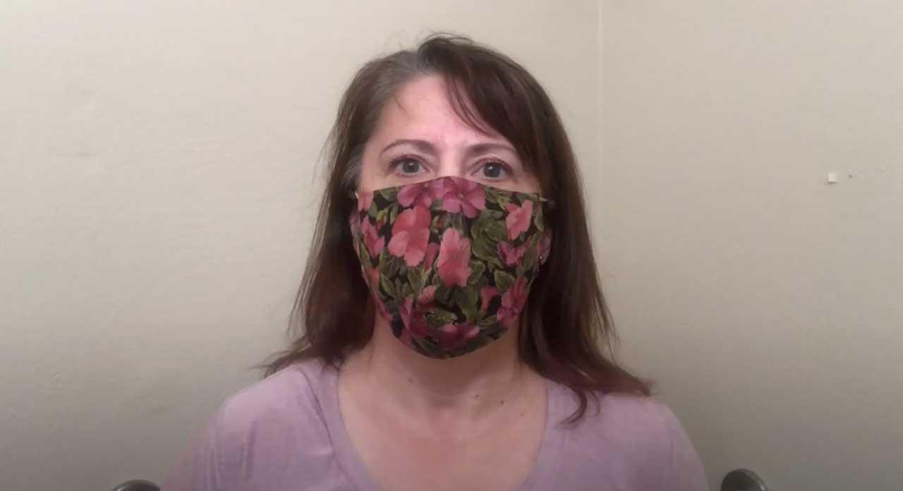 woman wearing flowered mask