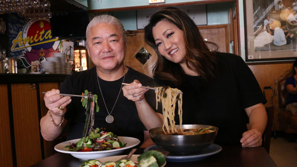 Ji Suk Yi with Bill Choi, chef and owner of Amitabul, a vegan Korean restaurant in the Norwood Park neighborhood of Chicago.   Brian Rich/For the Sun-Times