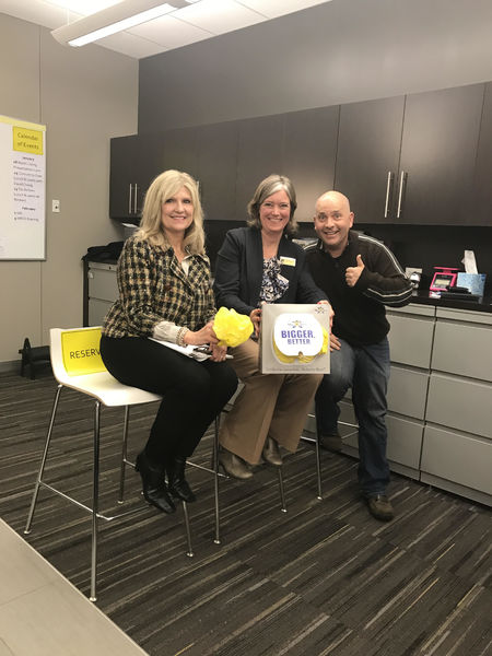 Glenbrook agents celebrate the results of a listing game