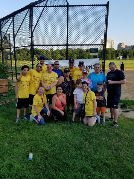 Team members of Baird & Warner North Center enjoy a softball game
