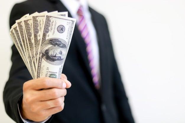 Man holding dollars
